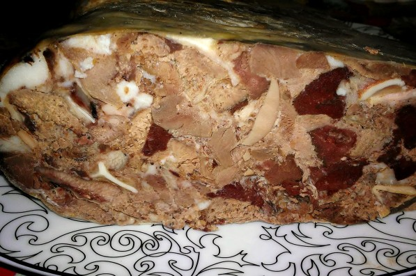 Traditional headcheese in cow stomach
